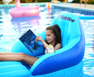 Alani Wheatley reads Harry Potter while relaxing in her grandparents' pool. She is the daughter of Amy and Matthew Wheatley.