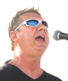 """A singer with the Perfect Fit Band from Campbellsville sings """"Play that Funky Music."""""""