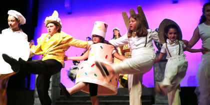 "The Beauty and the Beast Junior actors and actresses perform a dance routine during the performance of ""Be Our Guest"" at a dress rehearsal Thursday."