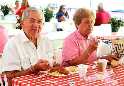 Marion County natives William and Patsy Tatum of Louisville enjoy a country ham breakfast on Saturday morning. While they live in Louisville now, they said they never miss the Marion County Country Ham Days Festival.