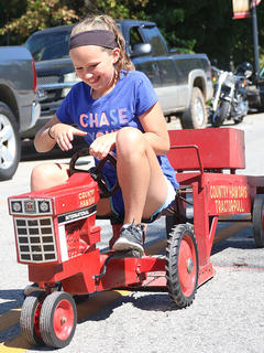 Lindsey Craig cracks as smile as she competes in the Peddle Pull on Sunday.