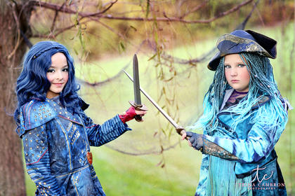Maddie Spalding, left, dresses up as Evie and Reese Cambron dresses up as Uma from Descendants 2.