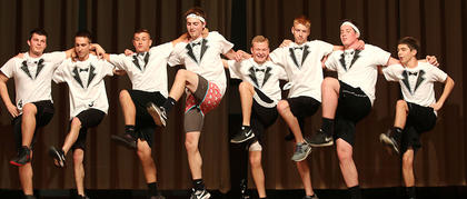 Pictured is the MI-6 participants do their best cancan dance during the physical fitness routine. They are, from left, Michael Richardson, Ben Buckman, Sam Beyer, Joe Craig Riggs, Matthew Huff, Addison Stiles, John May and Dylan Cambron.