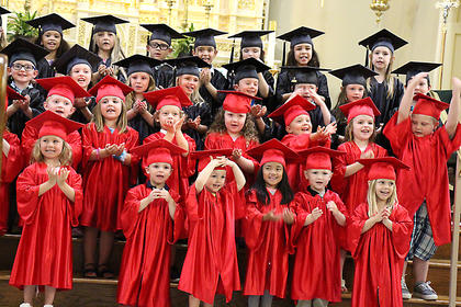 Preschool graduates perform during their graduation ceremony at St. Augustine Grade School recently.