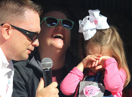 "Olivia Grace Bland was simply not having it during the Little Miss Ham Days competition on Saturday morning. Also pictured are emcee Jeremy ""Breakfast Boy"" Bowman and Olivia's mother, Amy Corder Bland."