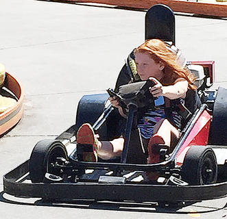 Emma Hardin, 9, drives a go-cart in Pigeon Forge, Tennessee.
