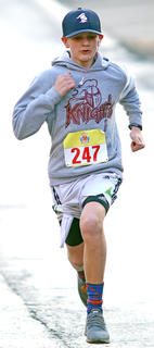 Harry VanWhy IV shows determination in finishing the All Fired Up About Baseball 5K on Saturday. His time was 24 minutes, 49.64 seconds for a fifth place finish.