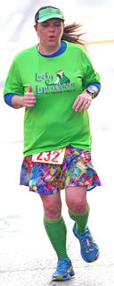 Bobbie Perkins is feeling lucky as she sports green in the All Fired Up About Baseball 5K on Saturday.
