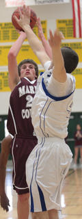 Freshman Clay Lanham pulls up for a jump shot in the opening round game against LaRue County.