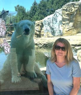 A polar bear poses for a photo with Tammy Washburn at the Louisville Zoo.