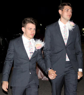 Mathew Pelfrey and Hayden Crain walk, hand in hand, into prom.