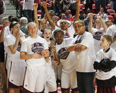The Lady Knights celebrate after winning the 2013 state championship.