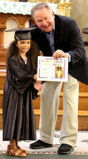 Harper Yocum receives her diploma from St. A Principal Paul Terrell.