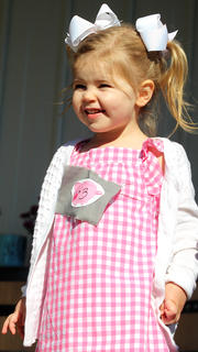 Maylee Marie Smith smiles at the crowd during the Little Miss Ham Days competition.