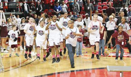 The Lady Knights run onto the court to receive the 2013 Sweet 16 State Championship trophy.