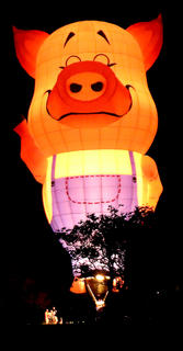 Farmer Pig lights up the night at Graham Memorial Park in Lebanon during the The Yellowstone Balloon Glow Saturday evening. The event was sponsored by Limestone Branch Distillery.