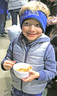 Sam Truitt samples the chili during the Marion County Chamber of Commerce's chili cookoff on Friday evening during the Dickens Christmas festivities. Deanna Hughes won first place in the chili cookoff and Tommy Glasscock won second place. More than $500 was raised for the Marion County Education Foundation.