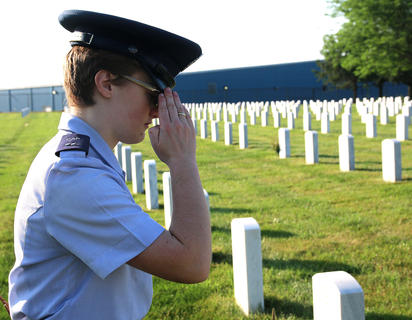 Cadet First Lieutenant Chloe Birt of Danville salutes the grave of a soldier buried at the Lebanon National Cemetery.