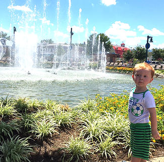 Liam Hardin, 2, checks out a water fountain in Pigeon Forge, Tennessee.