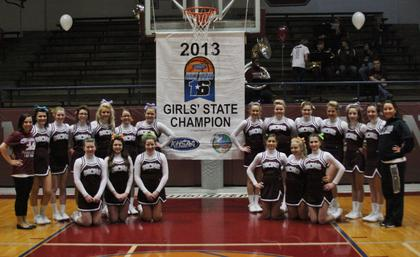 The Marion County High School cheerleaders pose with the 2013 State Championship banner.