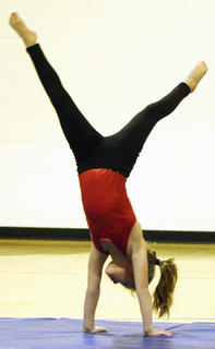 Brooklyn Mattingly wows the audience with her gymnastics routine.