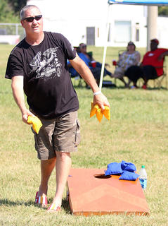 Terry Mathis prepares to throw a corn hole bag during the Miller Lite/Coors Light Cornhole Tournament Saturday.