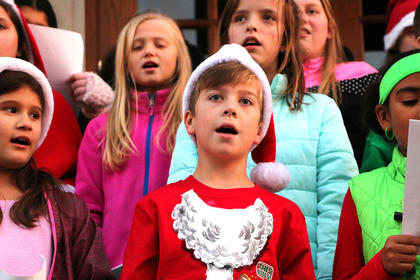 Keegan Cheser sings Christmas carols with fellow chorus students from Marion County Public Schools on the steps of the Marion County Heritage Center Friday evening.