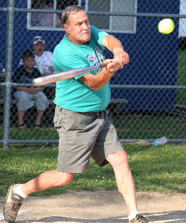 Larry Cook eyes the ball as he attempts to get a hit.
