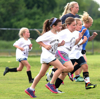 Campers do some jogging during the Marion County High School girls soccer team's camp last week at Marion County High School.