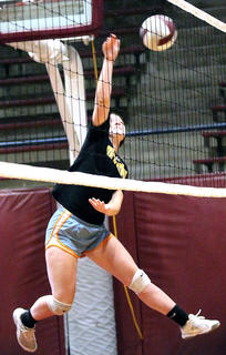 Nicole Fields bumps the ball during volleyball camp hosted by the Marion County High School volleyball team last Wednesday at Marion County High School.