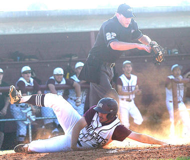 Travis Wiser slides across in the regional title game against Nelson County.