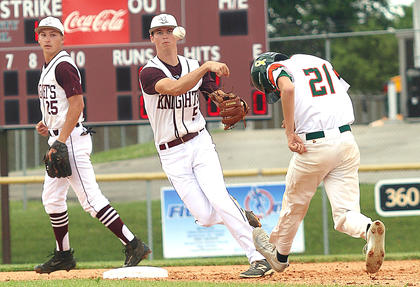 Andrew Spalding turns a double play to end the first inning against Hart County in the regional tournament as Kelly Mattingly(in background) watches.