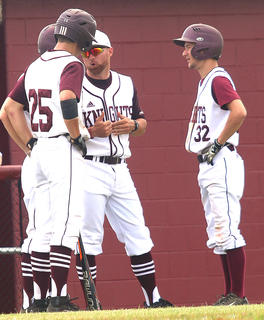 Marion County Head Coach Patrick Campbell speaks with his players in his team's 14-4 win over Hart County last Monday.