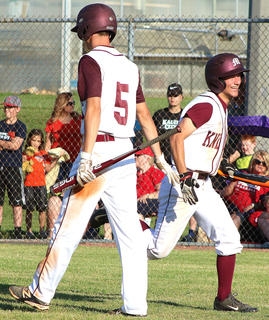 Andrew Spalding (No. 5) and a smiling Aaron Howard after Howard scores a run against Nelson County.