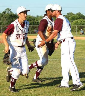 Head Coach Patrick Campbell (right) greets outfielders Dalton Hammond (left) and Cameron Nalley after the third inning.