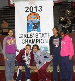 The 5 starters on the Lady Knights team pose with the championship banner.