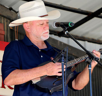 Deacon Joe Dant performs with the Honeysuckle String Band Sunday morning.