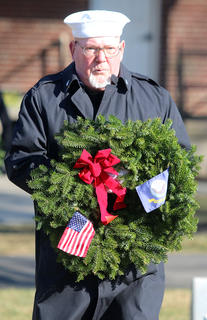 Lennie Nalley presents a special wreath in honor of the United States Navy.