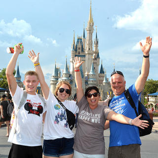 """We celebrated summer with the mouse!"" Christie Minor wrote when submitting this photo. Pictured, from left, are Tyler Wethington, Isabella Glasscock, Christie Minor and Chuck Minor at Walt Disney World in Orlando, Florida. It was Tyler's first trip to Disney, and he proposed to Isabella during the fireworks at the castle. She said ""yes."""