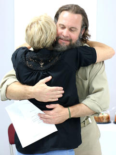 "Gerard Foote hugs his mother after being recognized for his completion of the R.E.A.C.H. Program at the Marion County Detention Center. R.E.A.C.H. program at the Marion County Detention Center Friday morning. R.E.A.C.H. is an acronym for ""Reentering American Communities with Hope."" The 24-week program not only attempts to help inmates overcome addiction, but also learn how to move on with their lives once they are released from jail."
