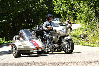 "This photo was taken in North Carolina on the Tail of the Dragon. Driving is Sherbie King and in the sidecar is his co-pilot, navigator and wife Karen King. The Kings drove more than 5,000 miles this summer on their rig. They traveled to Vermont, New Hampshire, Connecticut, Massachusetts, New York, Pennsylvania, Ohio, West Virginia, Virginia, North Carolina, South Carolina and Tennessee. They do their best to avoid interstates, large cities and chain hotels. They only eat at family own establishments in small rural towns. ""It's always an amazing journey to see America this way,"" Karen King said. ""There are still so many beautiful places we want to see. We meet the most unique interesting people on the way."""