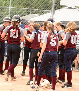 Emma Sullivan is congratulated at home plate by her teammates after hitting a grand slam to secure a 13-3 win over Russell Flatwoods on July 10.