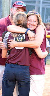 Caitlynn Brady shares a hug with her mother, Ashley Brady, after winning the state title against Boyd County.