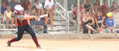 Emily Clark drives a hit to left center for a triple.