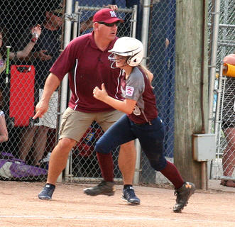Marybeth Overstreet dashes home as Joe Browning directs baserunners.