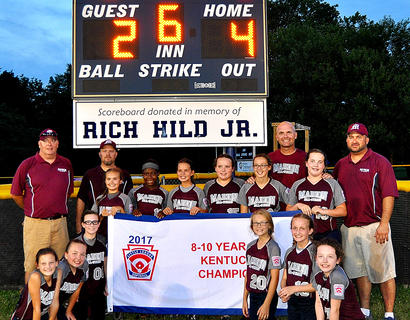 The Marion County 8-10 All-Stars are pictured with the state championship banner. Pictured are Makenzie Gordon, Laurel Cochran, Maggie Jo Benningfield, Kendra Gaddie, Keira Atkinson, Chloe Cox, Reece Caldwell, Caitlynn Brady, Rose Caldwell, Gracie Benningfield, Kaylee Reed, Gracyn Mattingly. The team was coached by Assistant Coaches Kevin Cochran, Daniel Mattingly, Terry Cox and Head Coach Jim Reed.