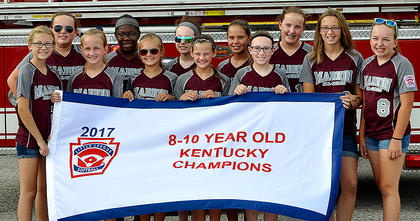 The Marion County 8-10 All-Stars are pictured with their state championship banner before departing from Marion County High School Friday afternoon in their victory parade