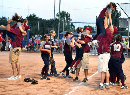 Assistant Coach Kevin Cochran and his daughter Laura Cochran (left), Head Coach Jim Reed and his daughter Kaylee Reed (middle) and Assistant Coach Terry Cox and his daughter Chloe Cox, (right) celebrate after the 8-10 All-Stars clinch the state title.