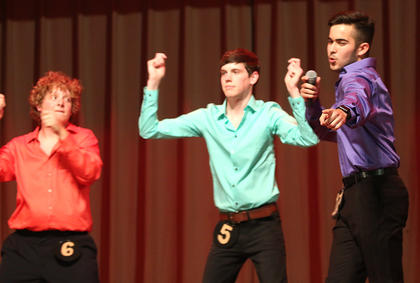 Diego Reyes, right, along with Luc Buckman and Noah Leake perform a Jackson Five Tribute during the talent portion of the competition.