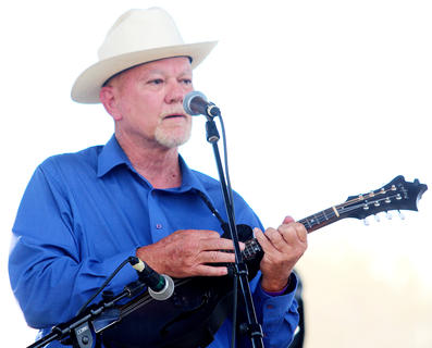 Deacon Joe Dant performs with the Honeysuckle String Band.